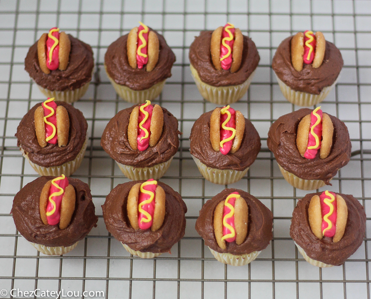 Mini Hot Dog Cupcakes - yellow cupcakes are topped with chocolate frosting and then decorated with a hot dog!  | ChezCateyLou.com