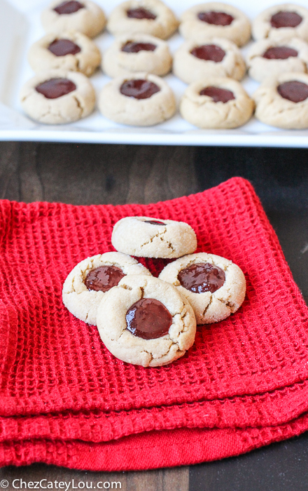 PBJ Thumbprint Cookies - the classic peanut butter and jelly flavor combo in a festive Christmas cookie! |ChezCateyLou.com