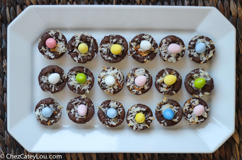 Mini Easter Brownie Nests - brownie bites are topped with toasted coconut and a candy egg to look like a bird's nest.  The perfect Easter treat! | ChezCateyLou.com