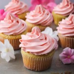 Baby Girl Cupcakes - yellow cupcakes with pink buttercream frosting | ChezCateyLou.com